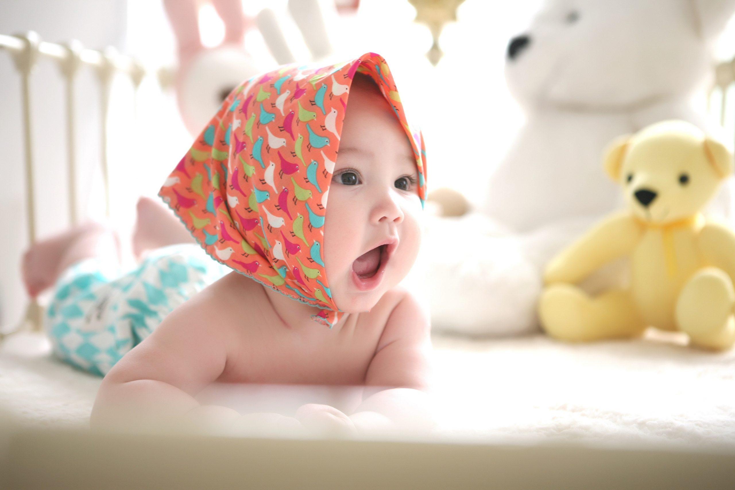 Baby on floor smiling