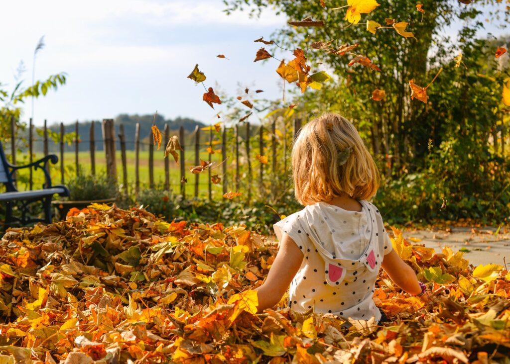Girl sitting in leaves