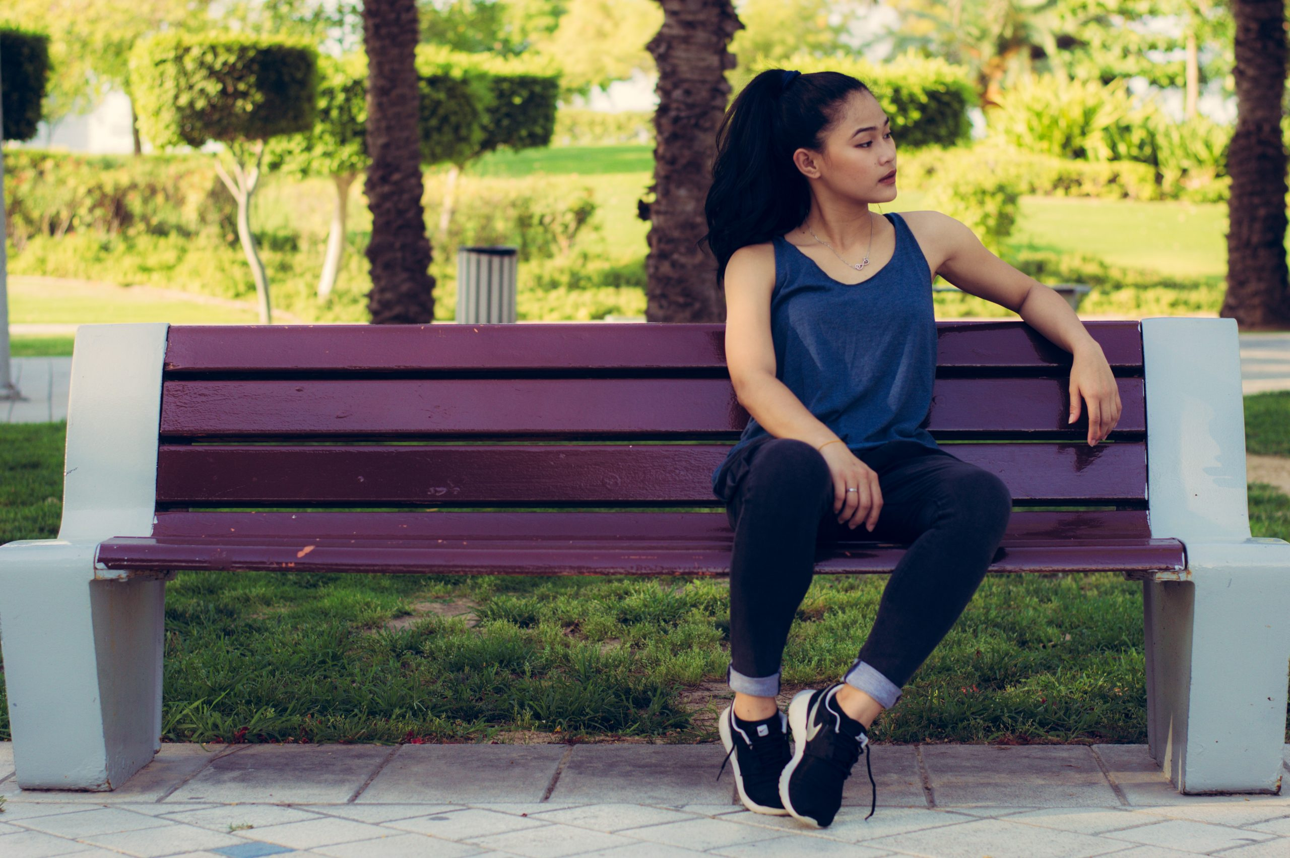 Young person sitting at bench