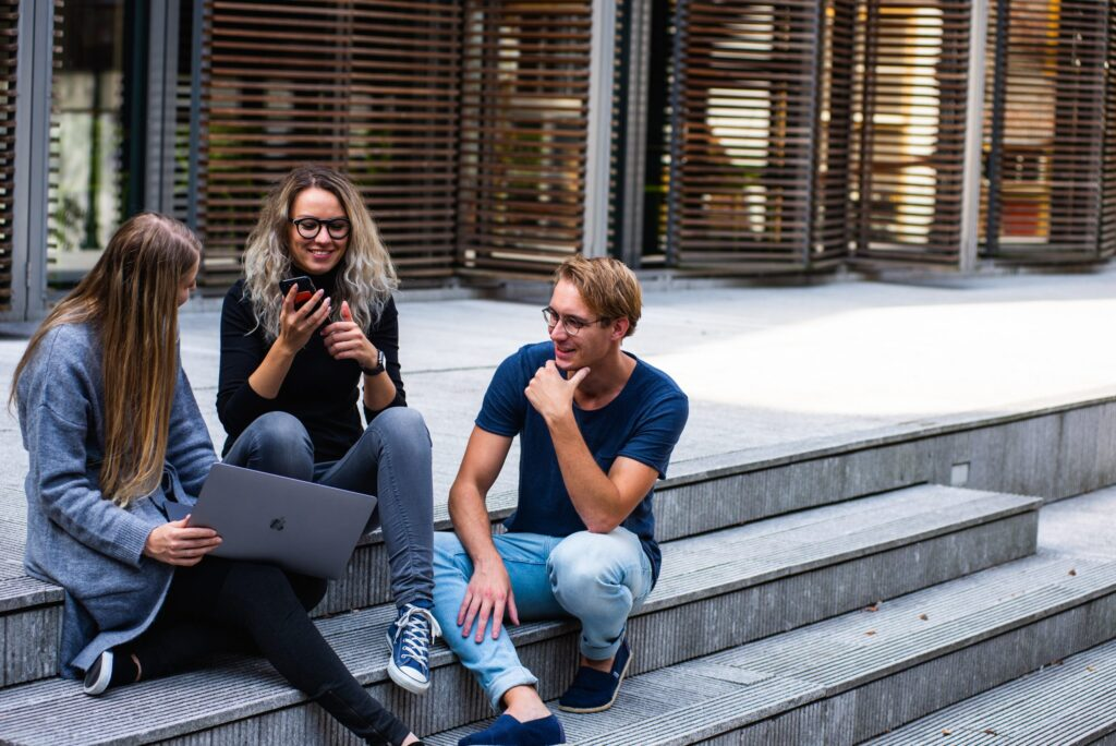 Three young people talking outside
