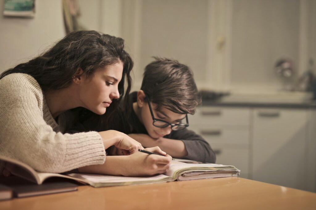 Mother helping child study