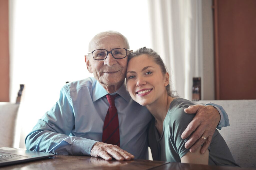 Elderly man and young woman