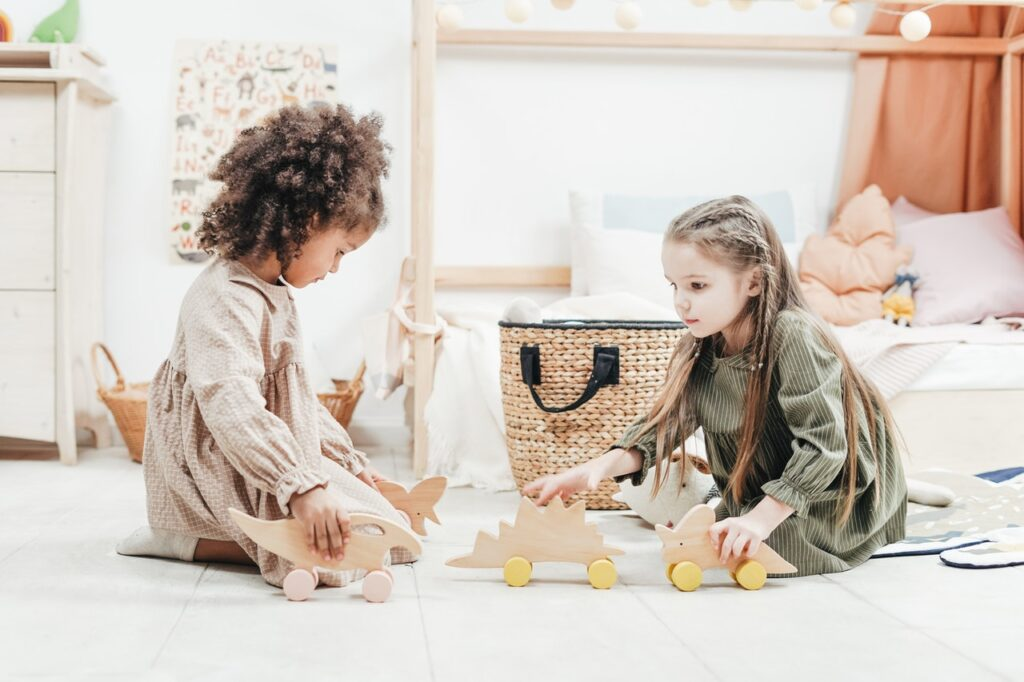 Two young children playing with toys