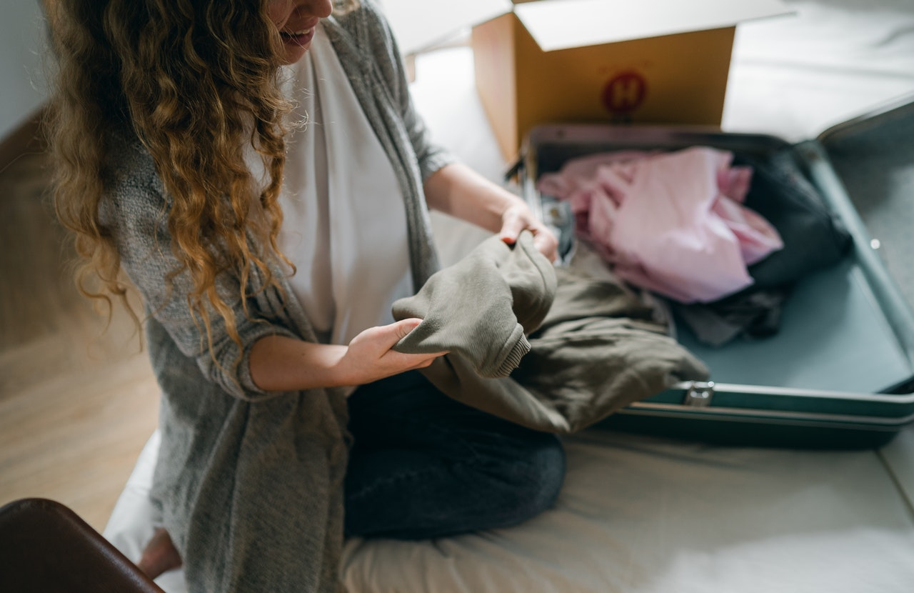 Woman packing clothing