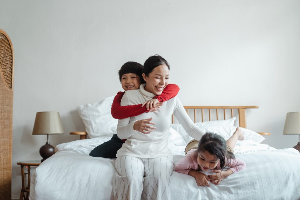 Family of three playing