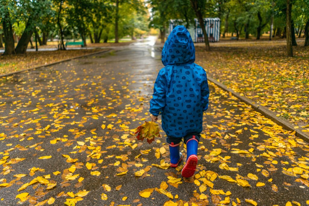 Child walking in rain