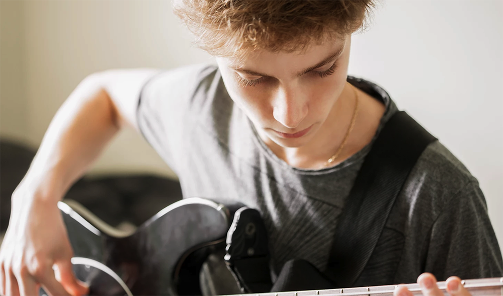 Young person playing guitar
