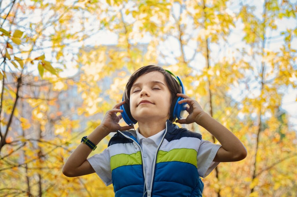 Child with headphones walking