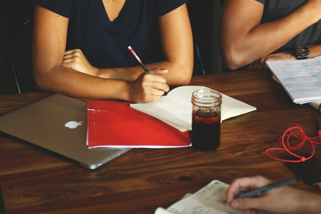 Women at desk writing